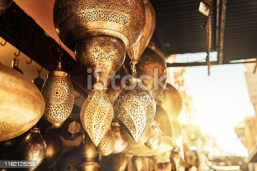 994119256istockphoto Retail store of traditional Moroccan bronze lamps in Marrakech old town (Medina). 1162125253
