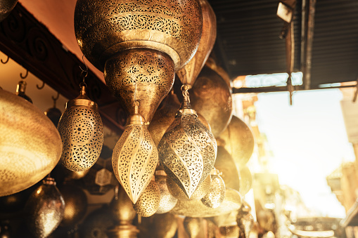 994119256 istock photo Retail store of traditional Moroccan bronze lamps in Marrakech old town (Medina). 1162125253