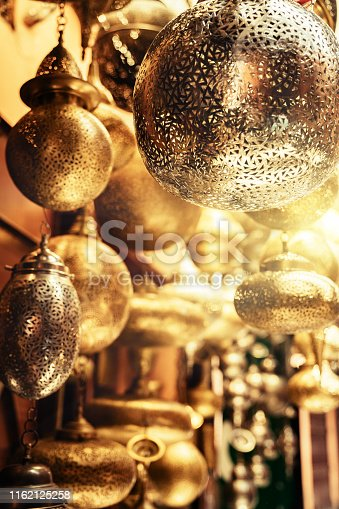 994119256istockphoto Retail store of traditional Moroccan bronze lamps in Marrakech old town (Medina). 1162125258