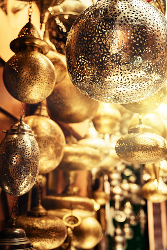 994119256 istock photo Retail store of traditional Moroccan bronze lamps in Marrakech old town (Medina). 1162125258