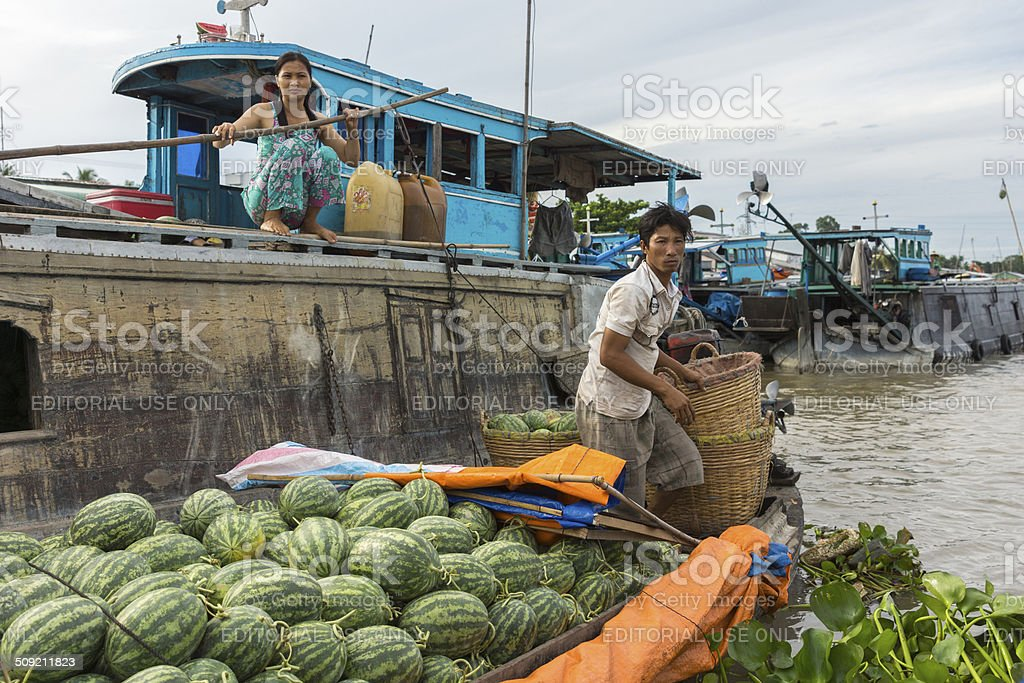 Retailer with water melons meets wholesaler. stock photo