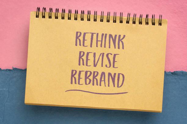 rethink, revise, rebrand - motivational handwriting stock photo