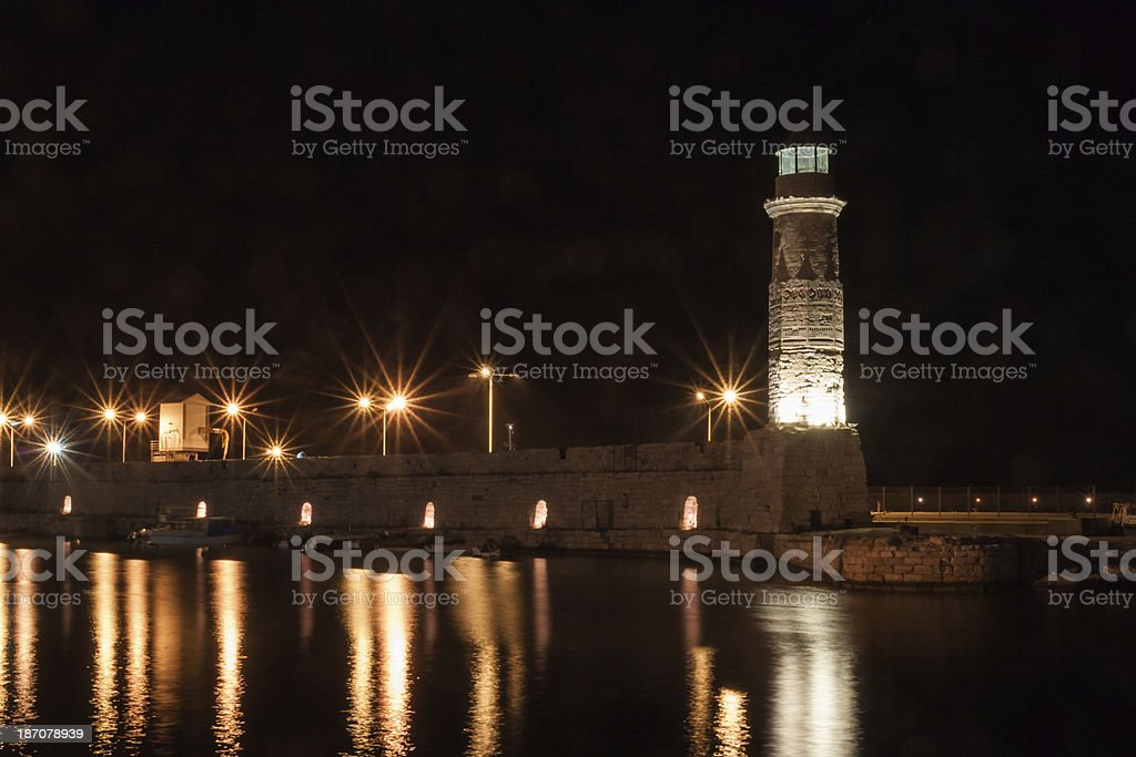 Rethymnon lighthouse at night. Crete, Greece. stock photo