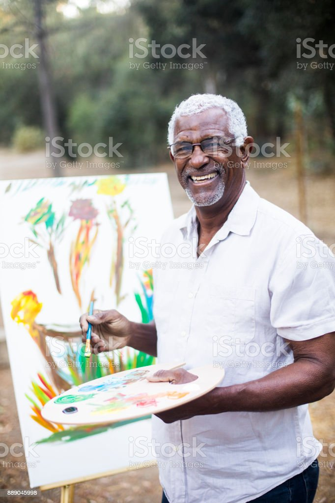 A retired black man painting stock photo
