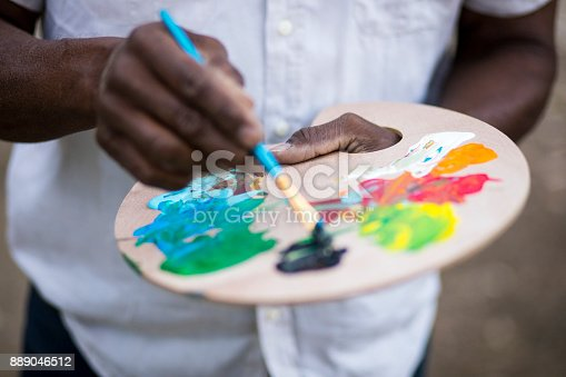 istock A retired black man painting 889046512