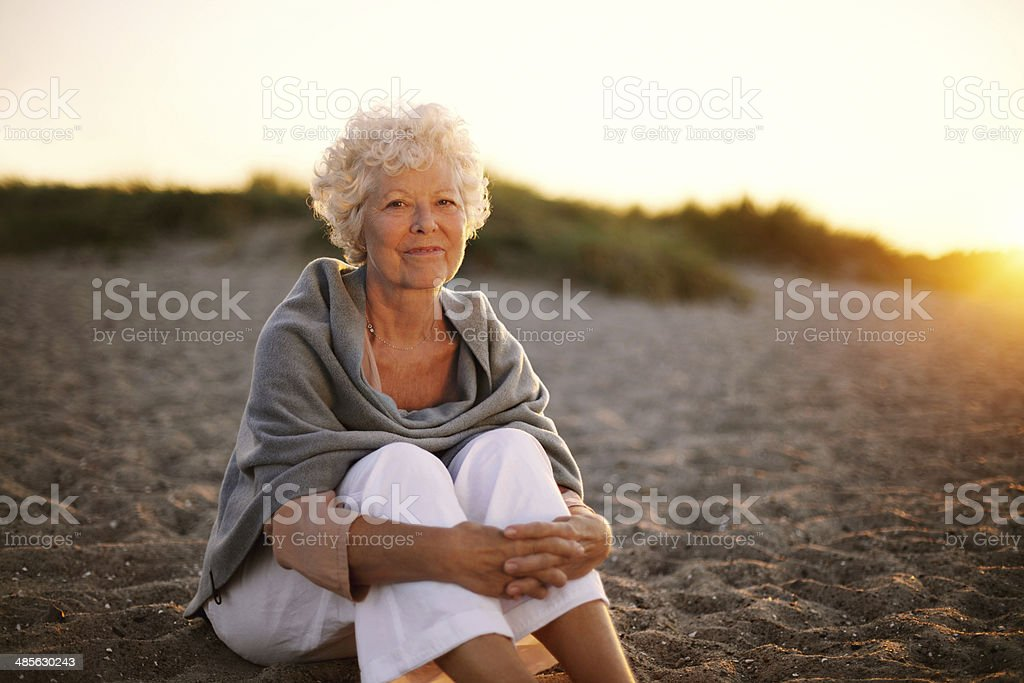 Retired caucasian lady relaxing outdoors stock photo