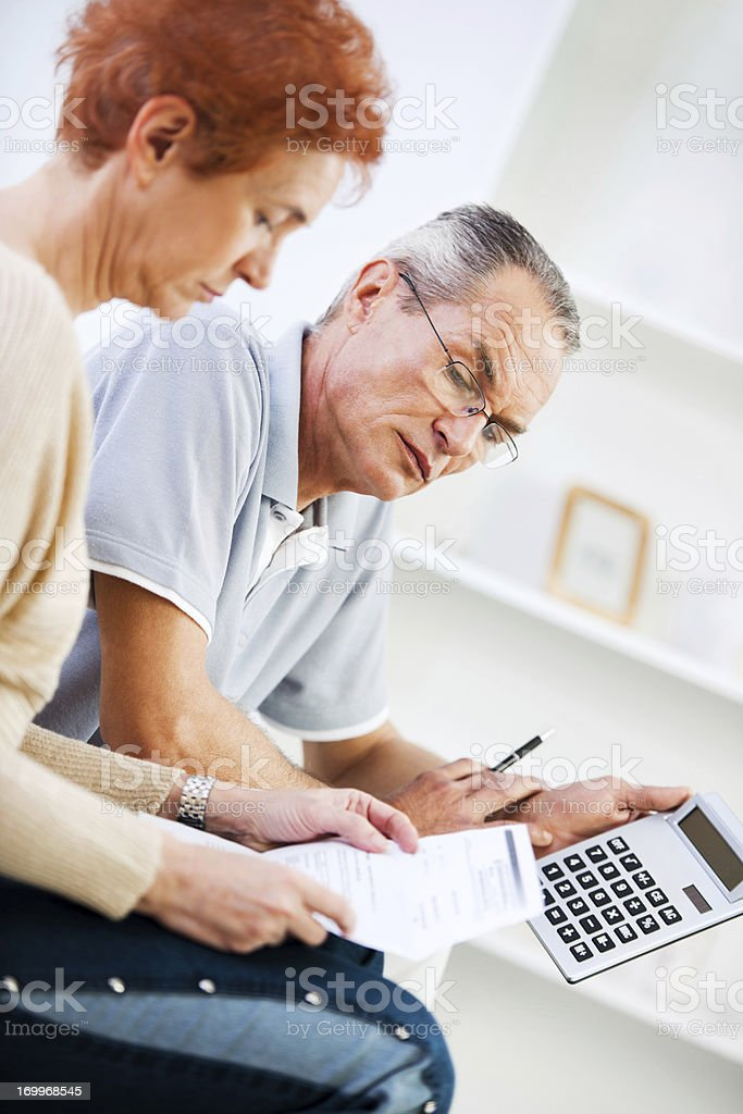 Retired couple doing their taxes. royalty-free stock photo