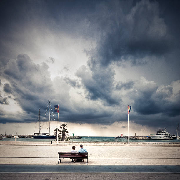 Retired couple facing the storm stock photo