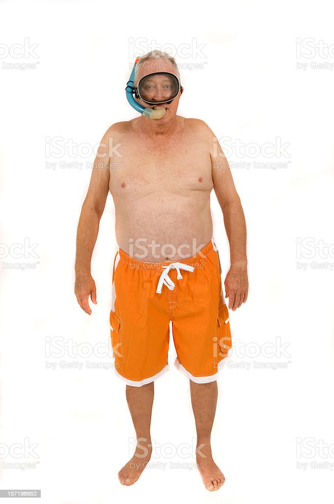 retired guy goes snorkeling stock photo
