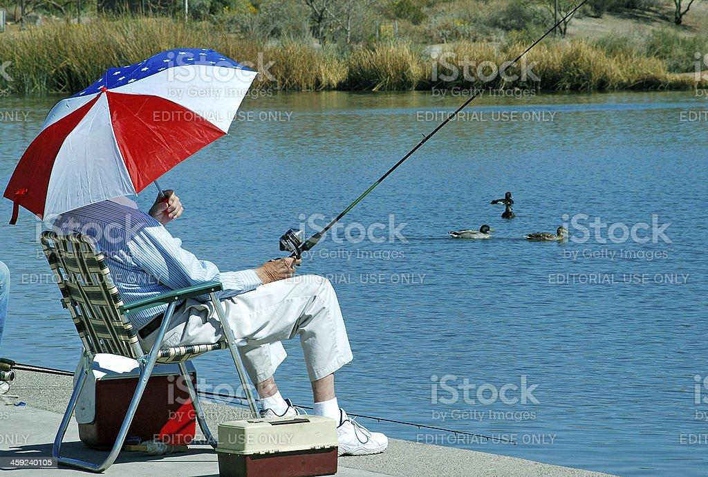 Retired man fishing in suburban Phoenix AZ royalty-free stock photo