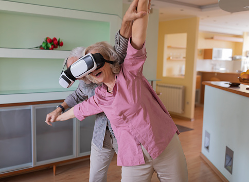 istock Retired Man Gesturing While Wearing Virtual Reality Headset Near Wife 1254250936