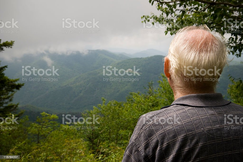 Retired man in the mountains royalty-free stock photo