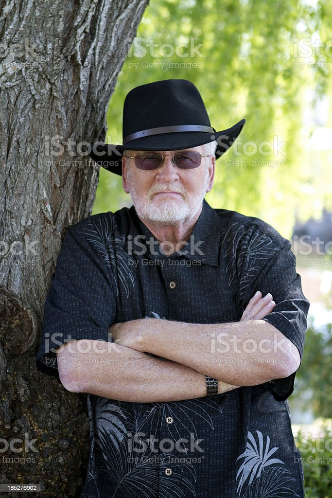 Retired Man with Cowboy Hat and Attitude stock photo