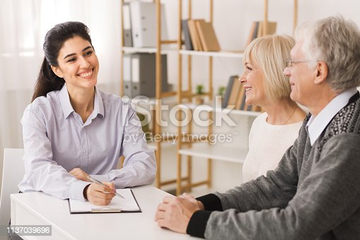 938640610 istock photo Retired old couple planning investments with financial consultant 1137039696