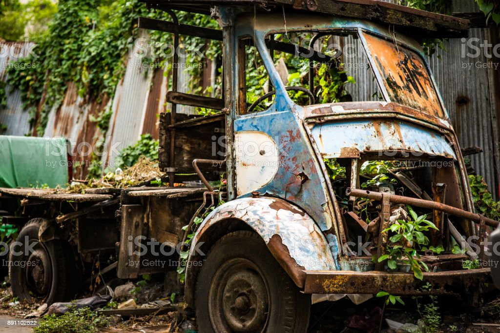 Retired, rusted car with interesting grunge metal texture stock photo