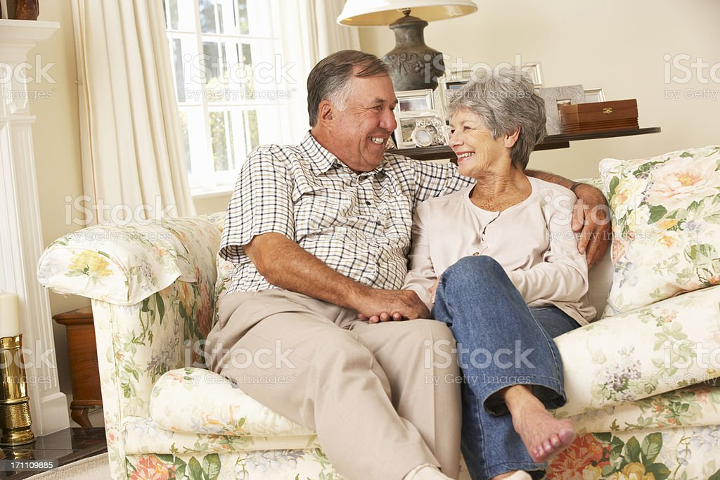 Retired Senior Couple Sitting On Sofa At Home Together royalty-free stock photo