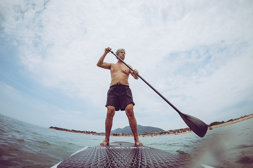 Retired Senior Man Enjoying The Day On The Sea Stock Photo - Download Image Now
