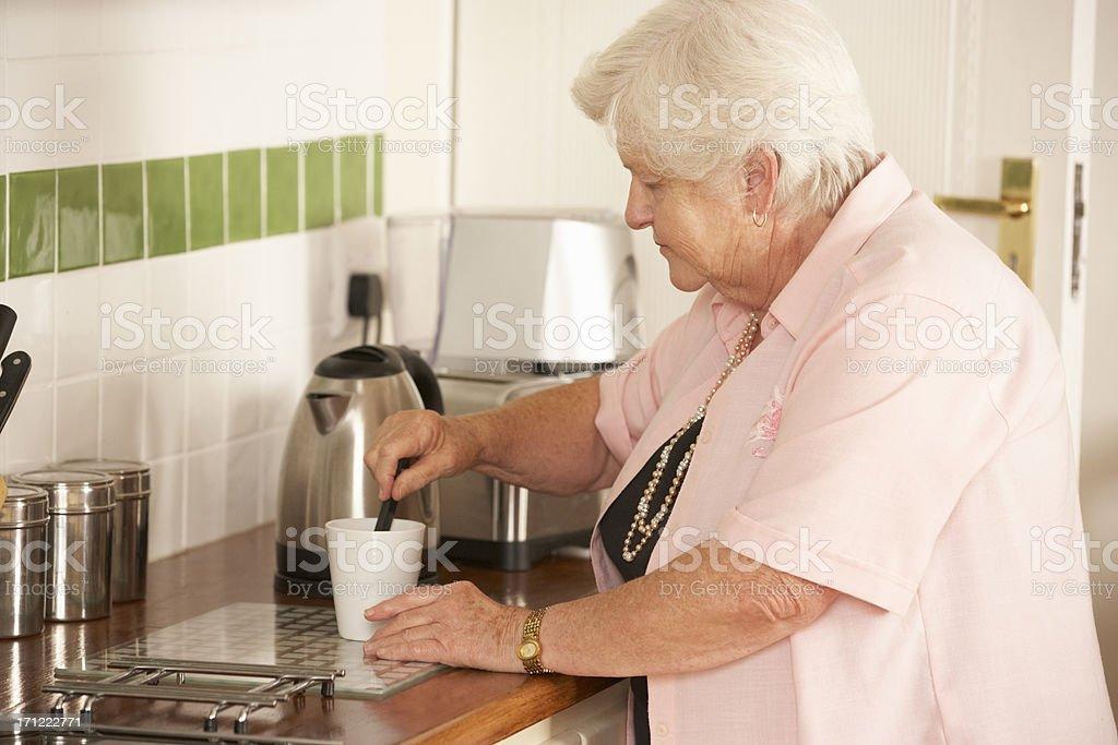 Retired Senior Woman In Kitchen royalty-free stock photo