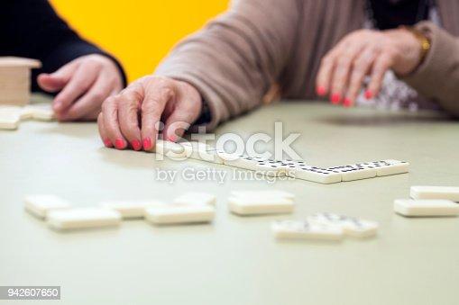 Retired Senior woman playing Domino