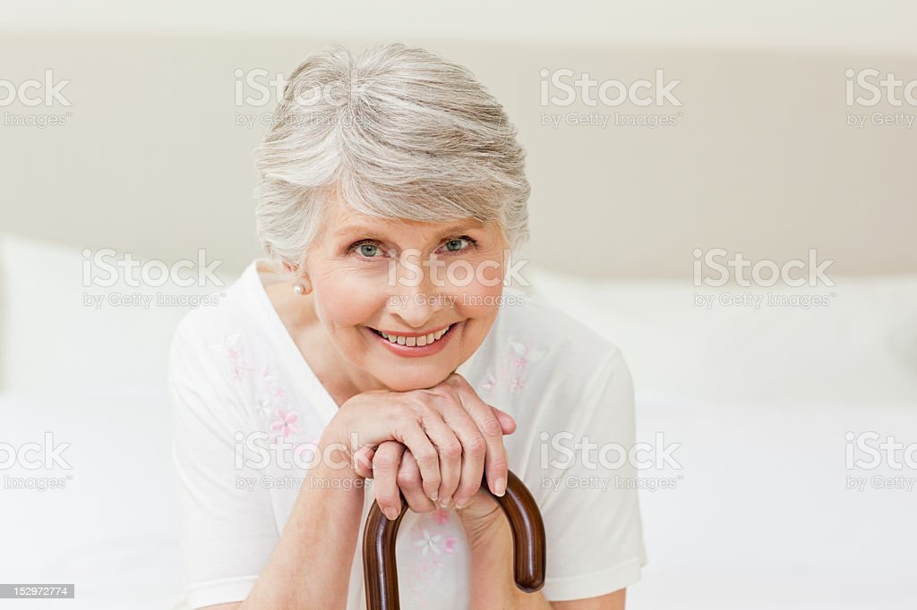 Retired woman with her walking stick royalty-free stock photo