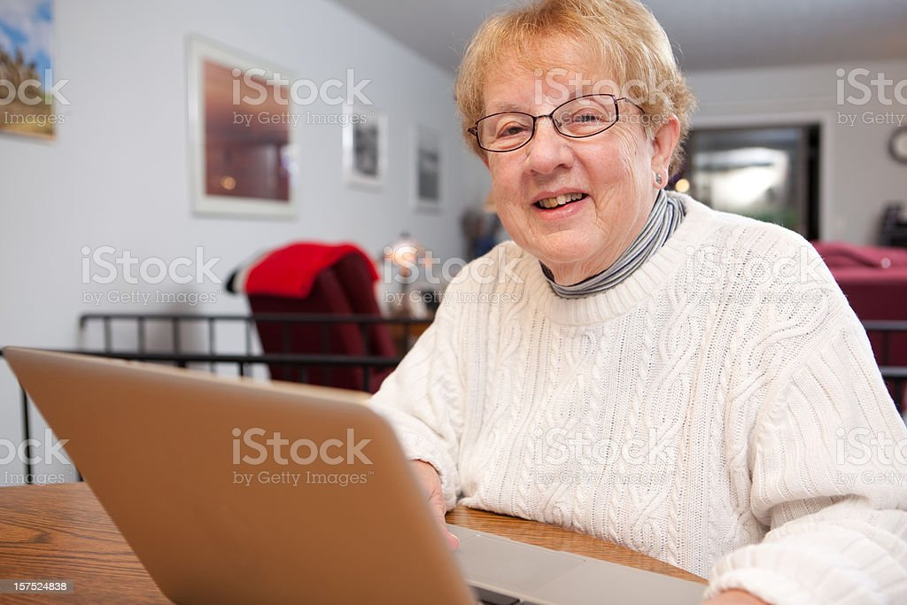 Retired woman working on a computer royalty-free stock photo