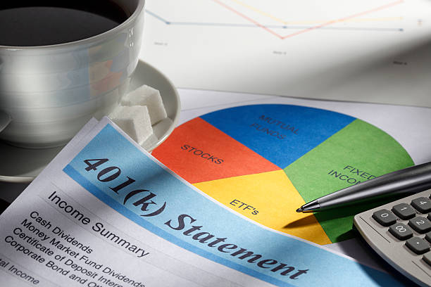 Retirement Account Statement And Pie Chart Close up of a 401(k) statement. The statement is surrounded by a cup of coffee, a pie chart of personal finances, a calculator and a pen with a soft focus on a graph in the background.  This image portrays the process of calculating personal finances and planning for retirement.  nest egg stock pictures, royalty-free photos & images