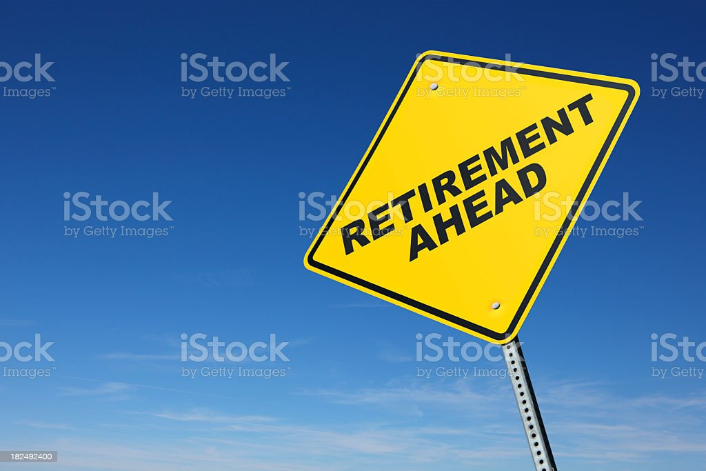 Retirement ahead road sign in front of clear blue sky stock photo