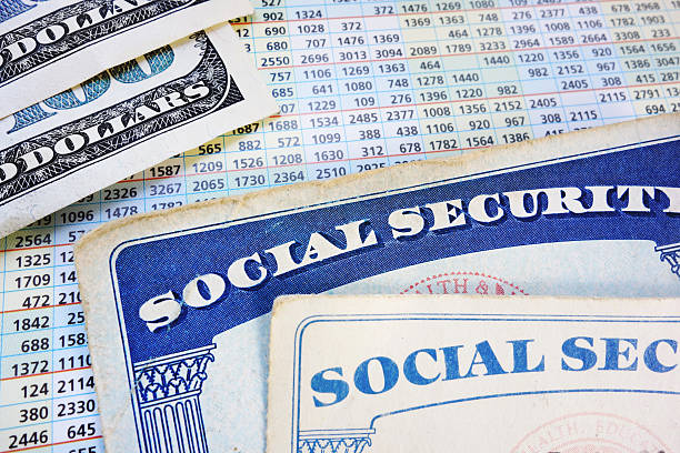 retirement benefits Social Security cards with cash and benefit amount numbers social security stock pictures, royalty-free photos & images