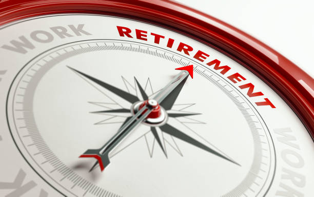 retirement concept: arrow of a compass pointing retirement text - retirement stock pictures, royalty-free photos & images