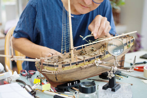 Retirement Hobby Leisure - Building Wooden Ship Kit Model stock photo