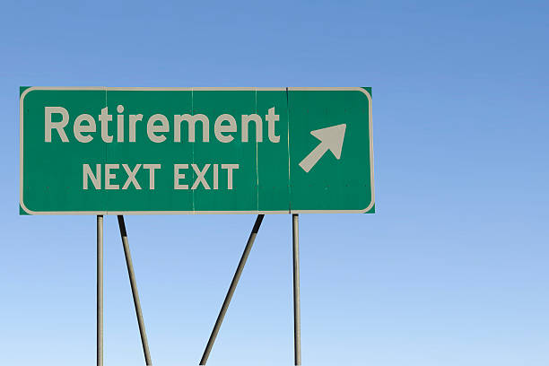 retirement - next exit road - exit sign stock photos and pictures