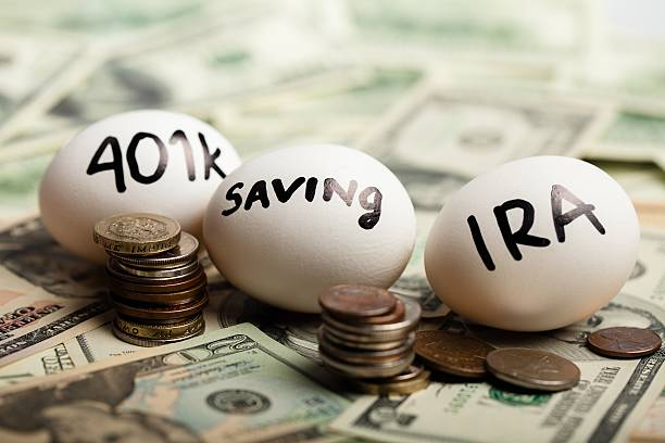 Retirement Start Thinking About Your Retirement - Nest Eggs On Dollar Bills 401k stock pictures, royalty-free photos & images