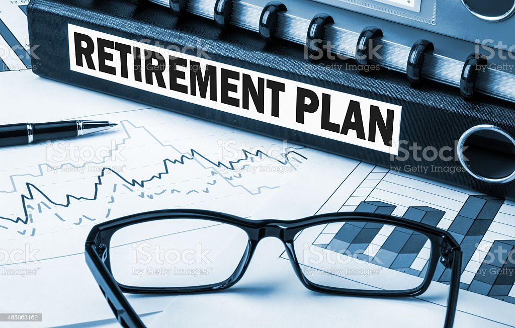 Retirement plan with graphs and glasses on desk stock photo