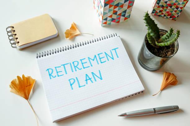 defterde yazılı emeklilik planı - emeklilik stok fotoğraflar ve resimler