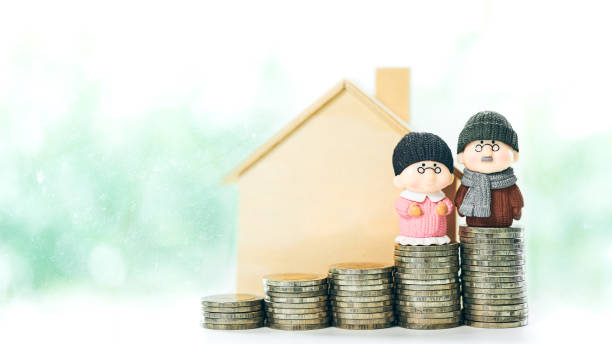 Retirement planning Concept of miniature old couple people figure standing on coin stack Retirement planning Concept of miniature old couple people figure standing on coin stack pension stock pictures, royalty-free photos & images