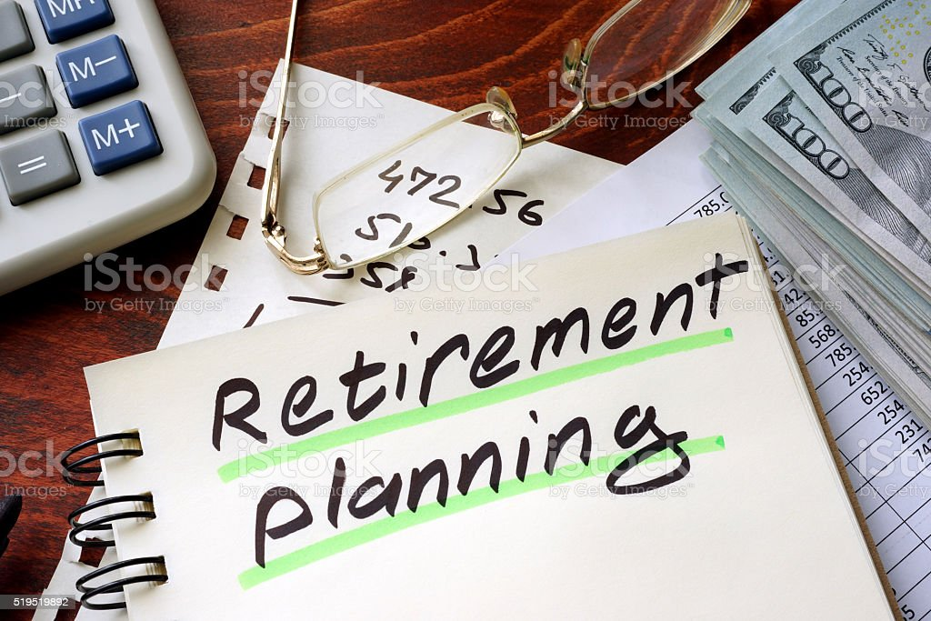 Retirement planning written on a notepad. stock photo