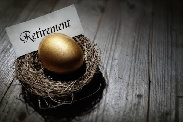 Retirement savings golden nest egg Golden nest egg concept for retirement savings nest egg stock pictures, royalty-free photos & images
