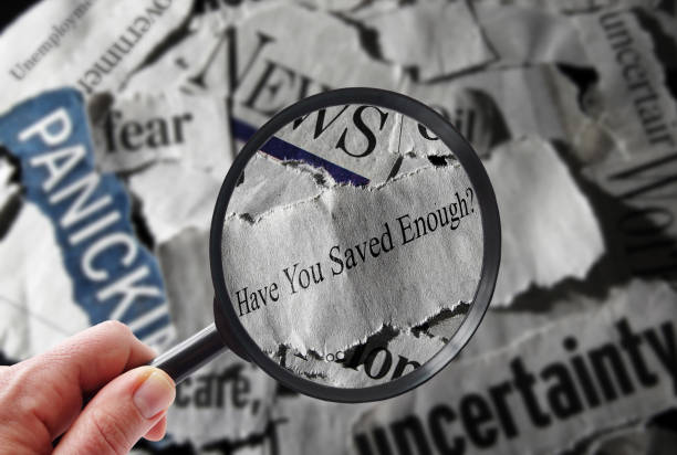 Retirement savings news question Retirement savings news headline, and magnifying glass nest egg stock pictures, royalty-free photos & images