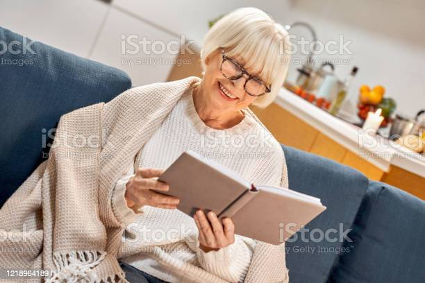 Retirement senior woman in eyeglasses sitting at home reading book picture id1218964189?b=1&k=6&m=1218964189&s=612x612&h=fsrq9euwxlbpnctpl nnyg98j 2bfr28khbi6purntu=