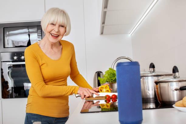 Retirement senior woman standing at kitchen cooking dinner asking to picture id1219064255?b=1&k=6&m=1219064255&s=612x612&w=0&h=inoedkx0ywasz7wrx93knqo4nyjq9ogug50t33ytiug=
