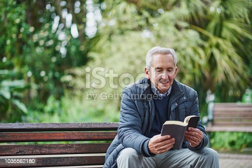Shot of a senior man reading a book and relaxing in the park