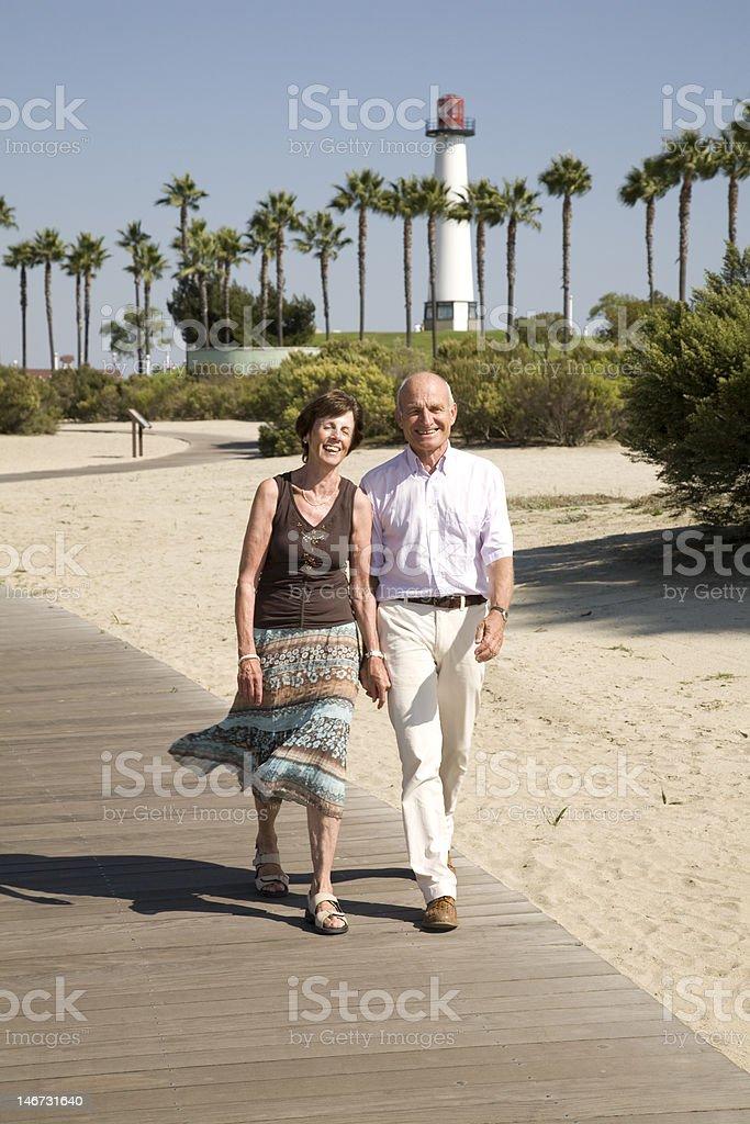 Retirement walk on the beach royalty-free stock photo