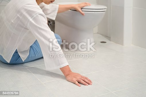 istock Retirement woman fell down in a restroom 544326794