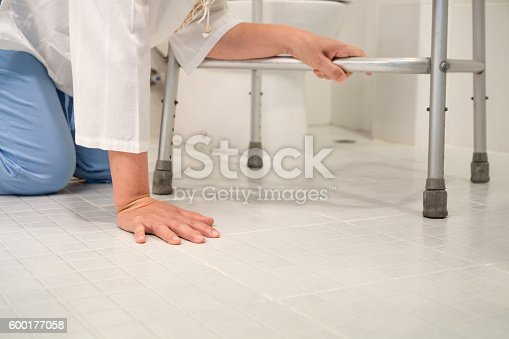 istock Retirement woman fell down in a restroom 600177058