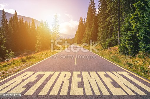 Retirement word written on road in the mountains