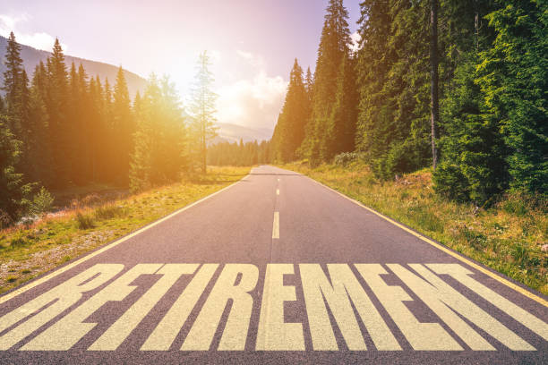 retirement word written on road in the mountains - retirement stock pictures, royalty-free photos & images