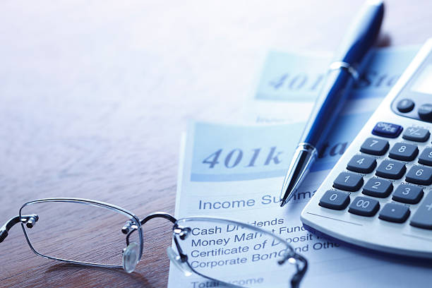 Retirerment Account Statement Close up of a 401(k) statement.To see more of my financial images click on the link below: 401k stock pictures, royalty-free photos & images