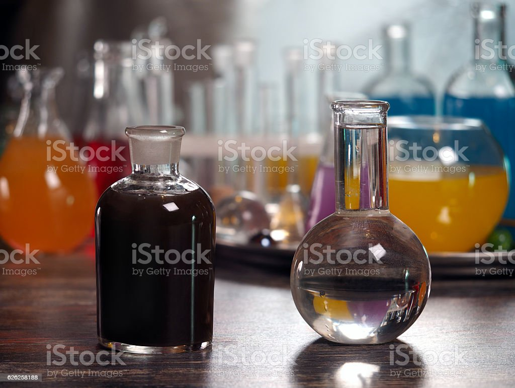 Retort with clear water and a dark bottle stock photo