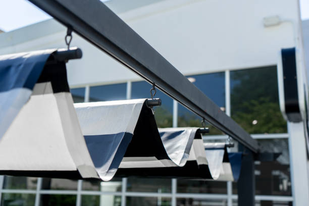 Retractable awning of roof for protect sun at the garden Retractable awning of roof for protect sun at the garden awning stock pictures, royalty-free photos & images