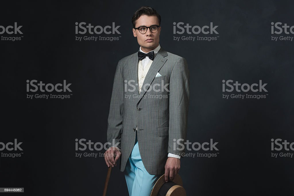 Retro 1920s business man with hat and cane. stock photo